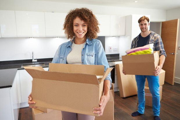 http://www.dreamstime.com/stock-photos-couple-moving-new-home-unpacking-boxes-whilst-looking-camera-smiling-image34163193