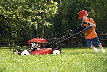 kid mowing the lawn